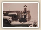 Dr. W.W. Washam was town doctor for 50+ years. Shown here at Lee Proctor's Esso station, across Main Street from Brick Row (1933).